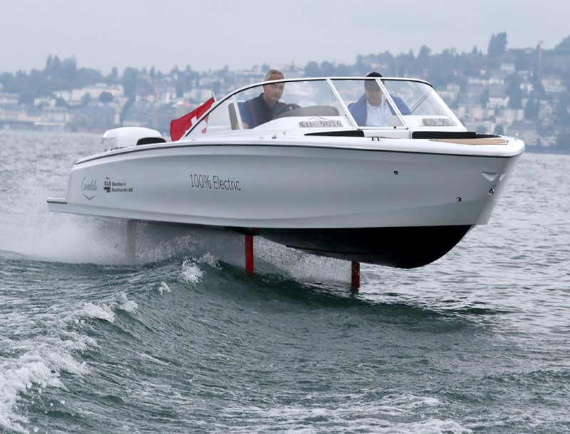 Christian Vogel (L), manager of W.A.R. Bootbau und Boothandel AG steers an electric powered Candela Seven boat on Lake Lucerne near Luzern, Switzerland September 2, 2020.