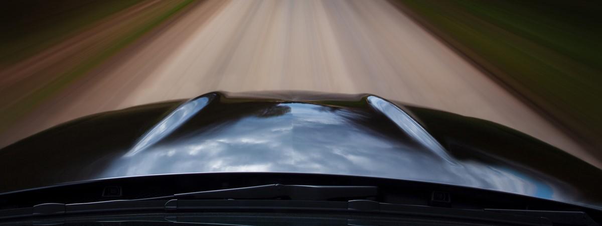 Car-on-the-road-resized.jpg?center=0.60383386581469645,0
