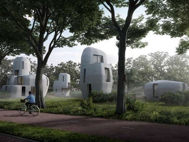 Cyclist passes 3D printed homes (concept art)